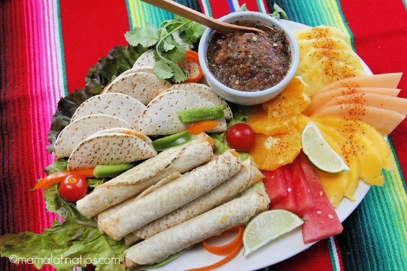 Flour taquitos, red salsa and fruit