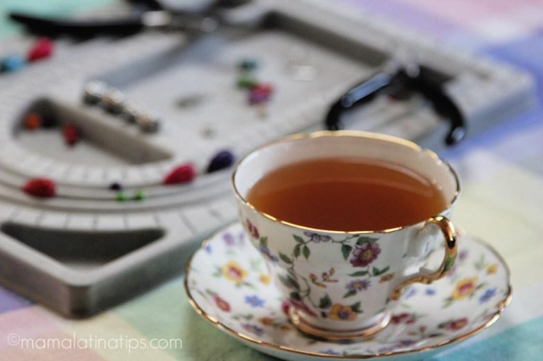 A floral tea cup with cinnamon spiced tea