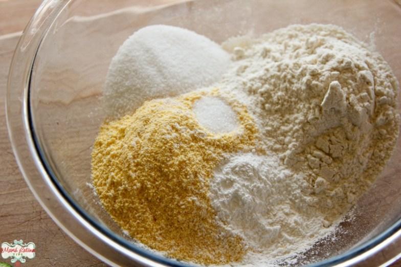 Cornmeal, salt, flour and sugar in a glass bowl