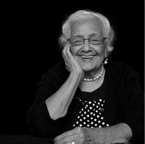 Black and white photograph of a female senior citizen smiling