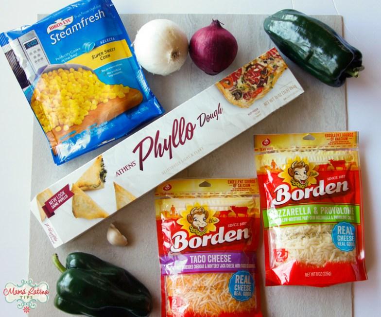 box of Athens Phyllo Dough, bag of birds eye corn, borden cheese and poblano chiles