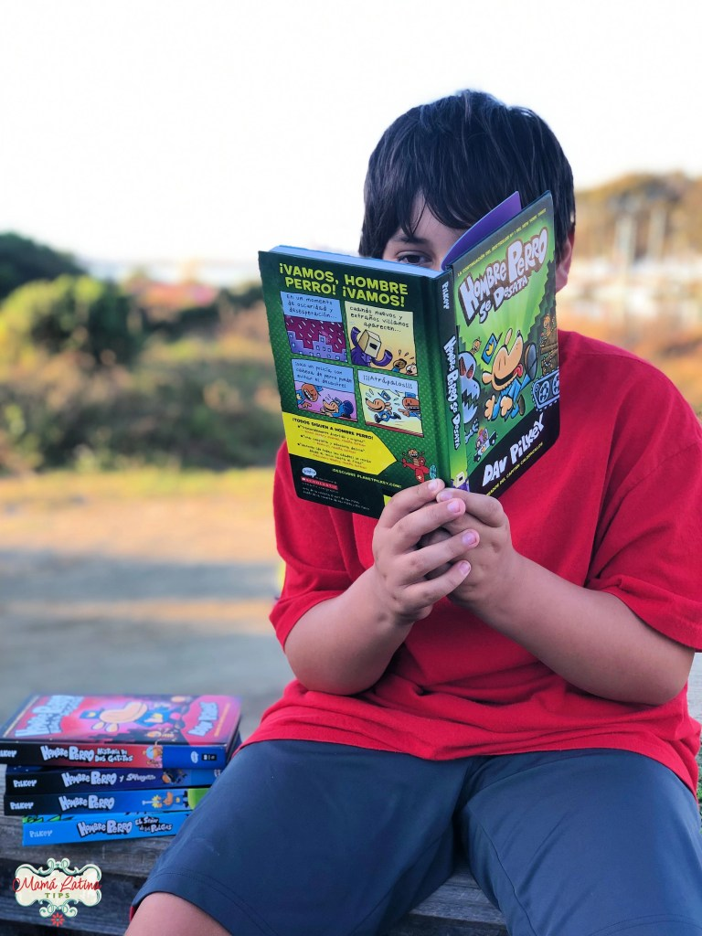 Kid reading a book by Dav Pilkey