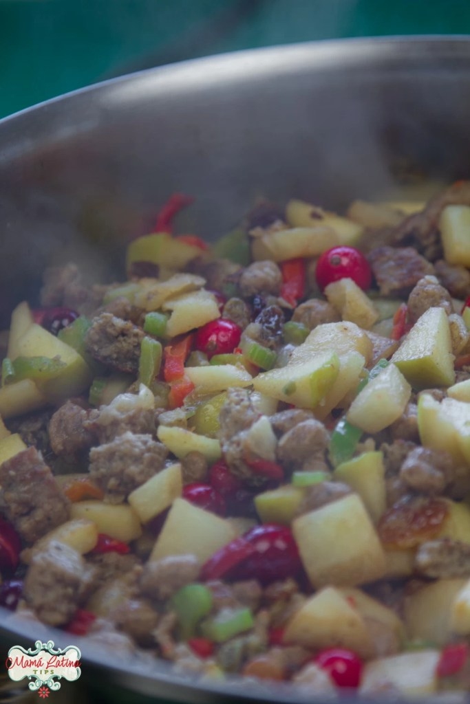 sausage, veggies and fruits cooking in skillet