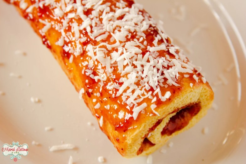 Mexican jelly roll with strawberry jam and coconut