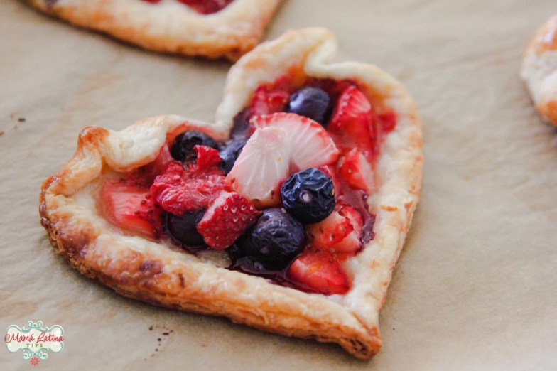 heart shaped tart with blueberries and stawberries