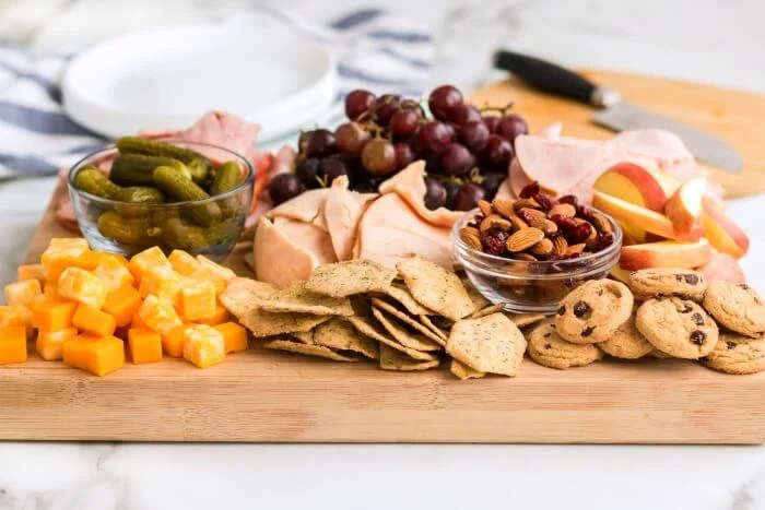 WHAT DO YOU SERVE ON A CHEESE BOARD