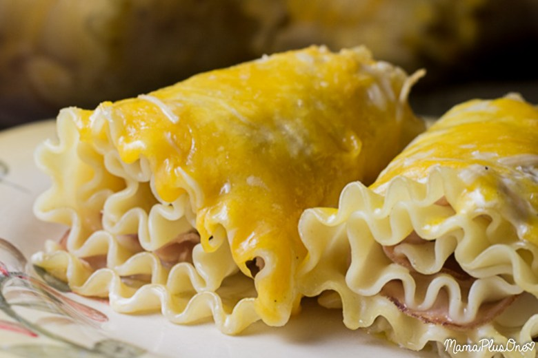 Ham and Cheese Lasagna Roll Ups are the perfect choice for a weeknight meal. They're easy to make and taste delicious, pairing your favorite ham and cheese sandwich with a delicious lasagna twist. | weeknight meal | lasagna roll up | ham and cheese | easy dinner idea |