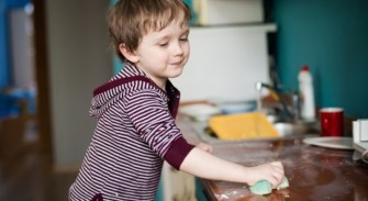 boy-cleaning-the-kitchen