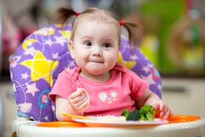 bigstock-kid-eating-food-on-kitchen-83698700