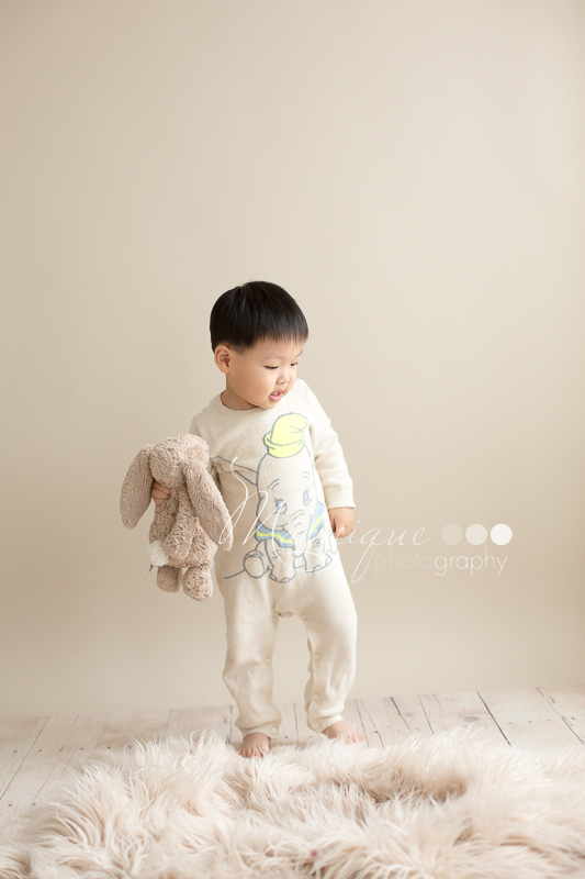 toddler boy walking with his favourite stuffed animal bunny