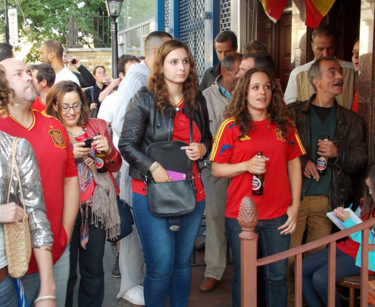 Spanish football fans gather outside El Galicia Restaurant in Portobello Road to watch Spain v Italy 2012 European Cup Final