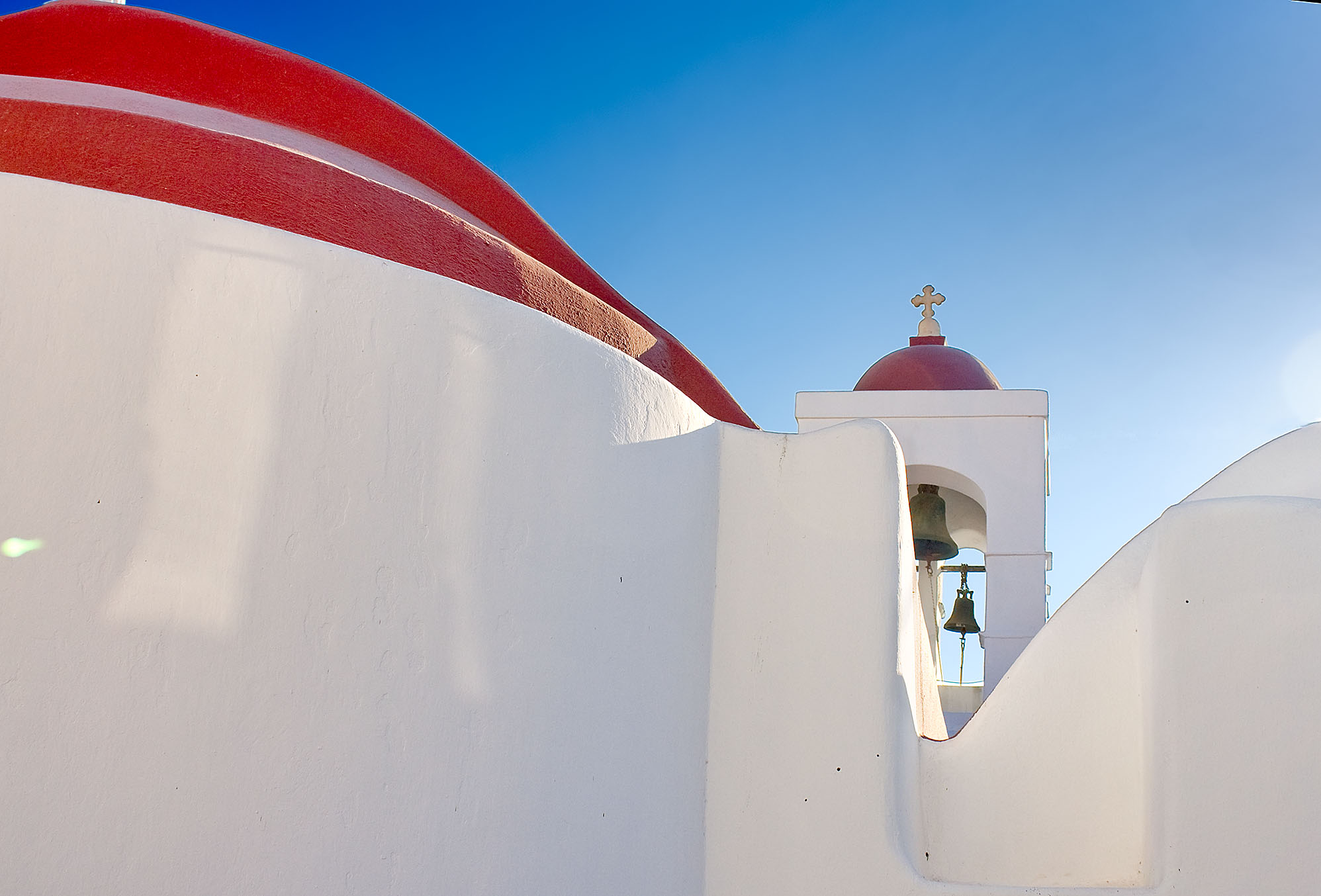 A red-domed church in Mykonos, as seen in ManAboutWorld, the gay travel magazine