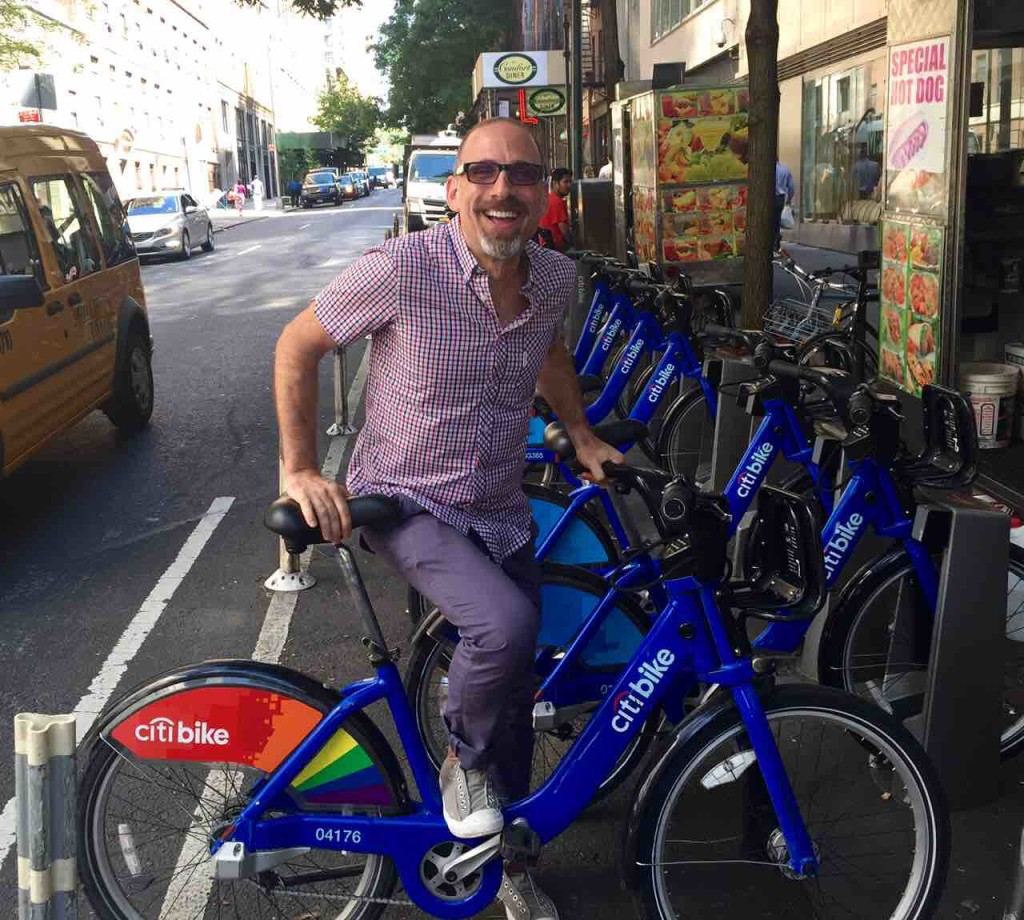Gay pride rainbow wrapped Citi Bike in London as seen in ManAboutWorld gay travel magazine