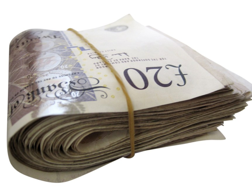 Pile of twenty pound notes. (c) 2011 TaxFix.co.uk Ltd.. (CC BY 2.0) Via flickr.