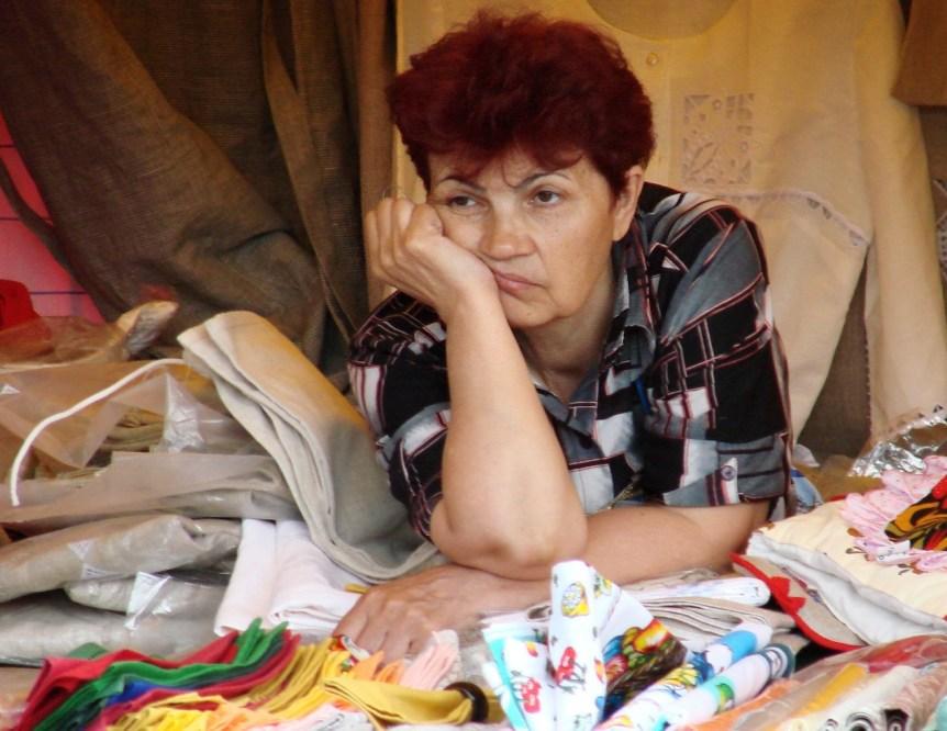 Bored souvenir seller in Moscow. Photo by Adam Jones adamjones.freeservers.com