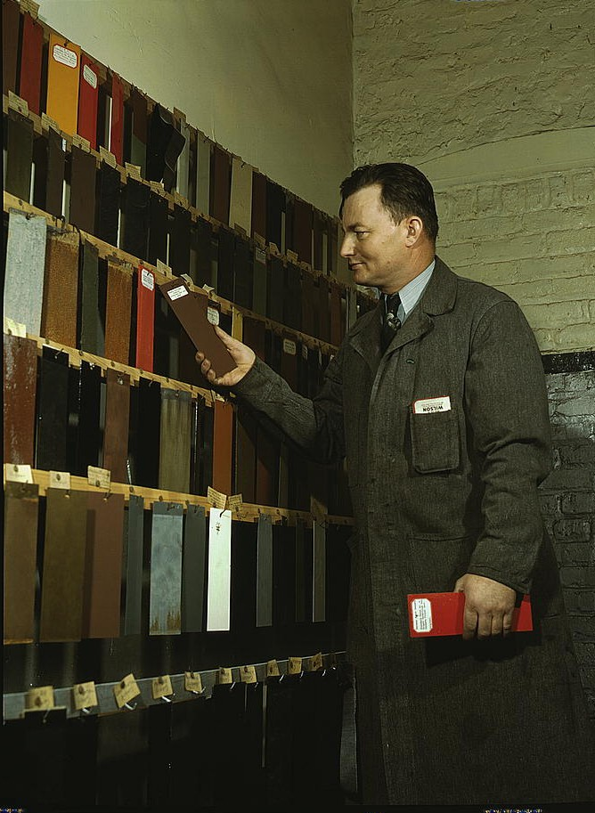 Laboratory worker at the research laboratory at the C & NW RR's 40th Street yard, examining paint samples used on freight cars and coaches of the railroad, Chicago, Ill. (LOC). By Delano, Jack.