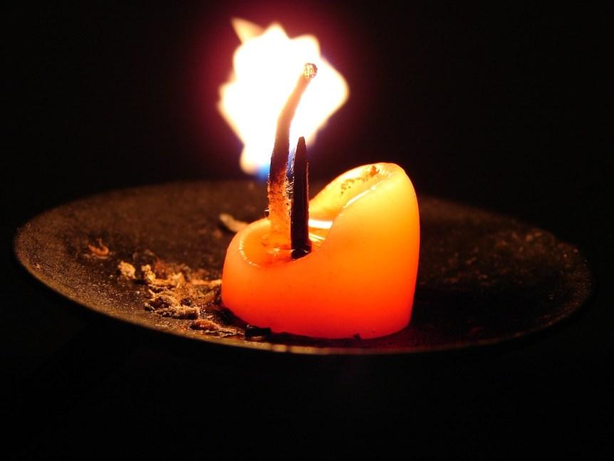 Candle in stump holder. (c) J. Samuel Burner (CCA-2.0) http://www.flickr.com/people/lobsterstew/