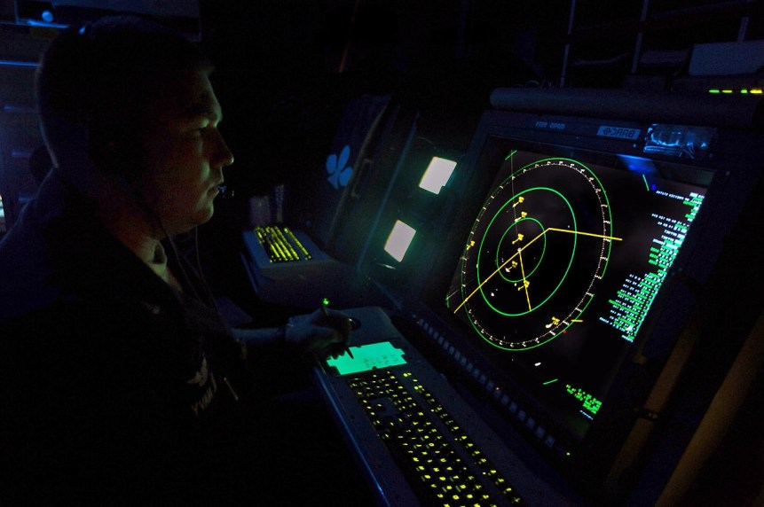 Air Traffic Controller 2nd Class Branden Powell keeps track of aircraft using a SPN-43 radar screen during routine flight operations on board amphibious assault ship USS Tarawa (LHA 1). Tarawa is participating in a composite unit training exercise with the 11th Marine Expeditionary Unit off the coast of Southern California. U.S. Navy photo by Mass Communication Specialist 3rd Class Bryan Niegel (RELEASED)