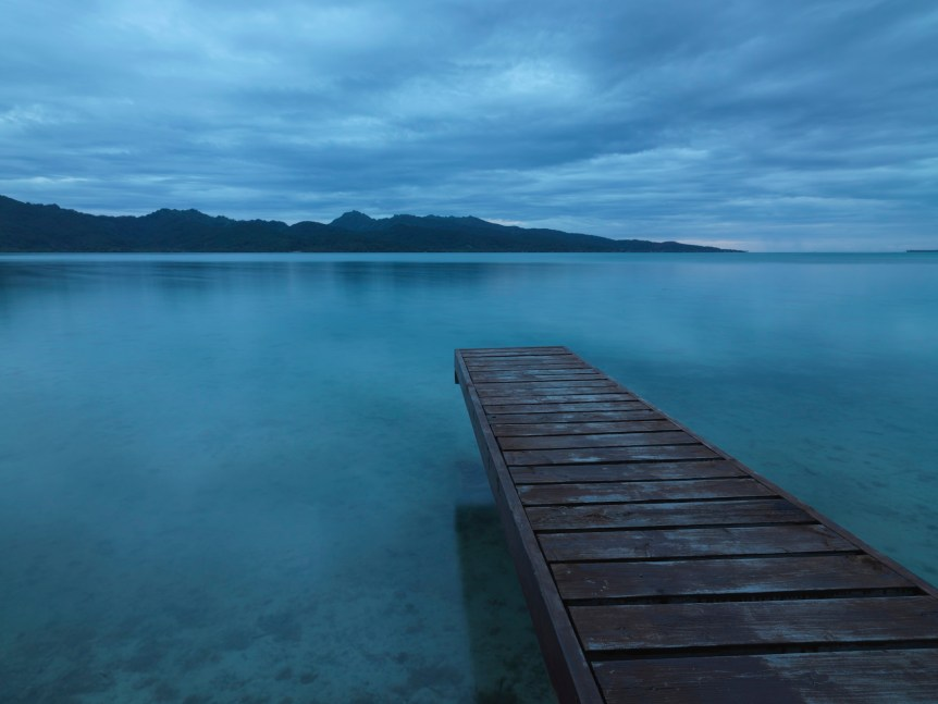 Tranquility. Lonely Pier towards Tahaa Island. © 2009 Mlenny Photography (iStockphoto)