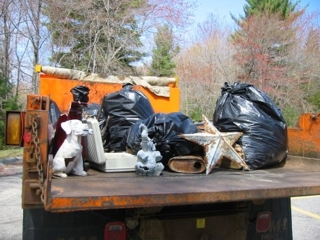 Abandoned items and trash collected from Manchaug Pond and nearby land during a previous cleanup.