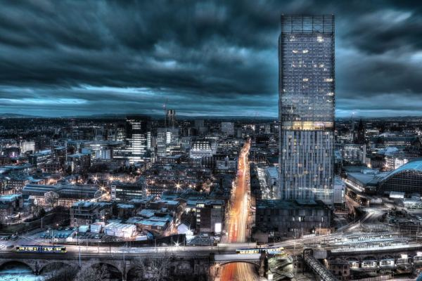 Long exposure night time cityscape photograph of Deansgate with the Hilton Hotel