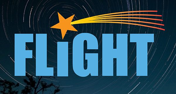 The word Flight with a shooting star as the dot on the i in front of a starry night background