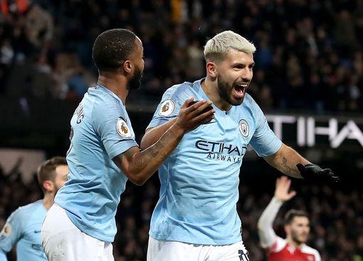 Sergio Aguero celebrates his third goal with Raheem Sterling