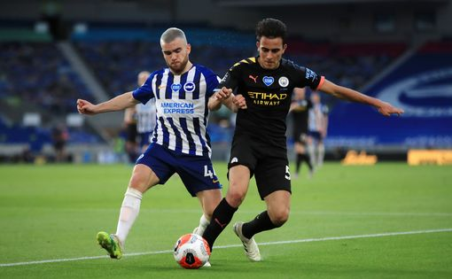 Brighton and Hove Albion's Aaron Connolly (left) and Manchester City's Eric Garcia