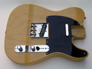 Butterscotch Telecaster body with hardware fitted