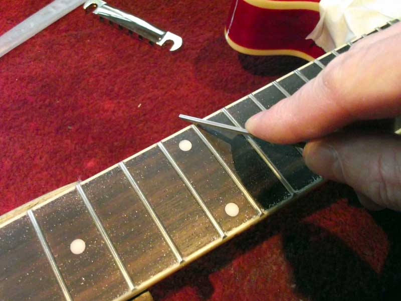 Dressing fret ends with a diamond file
