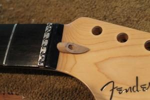 Test fit of new Fender USA walnut plug