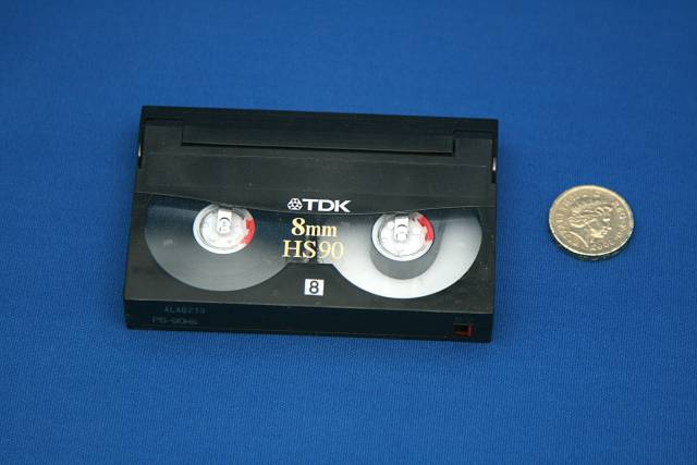 Video8 Cassette shown next to a pound coin for comparison