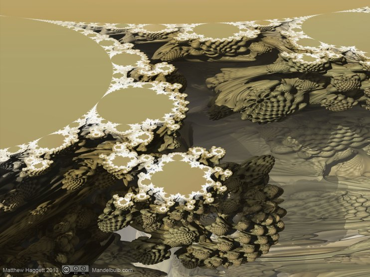 The familiar shape of the Mandelbrot set is apparent when the Mandelbulb is shown in cross section.