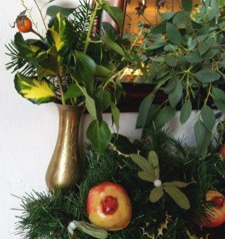 Small Turkish brass vase, foliage, papier mache pomegranates and mistletoe lights