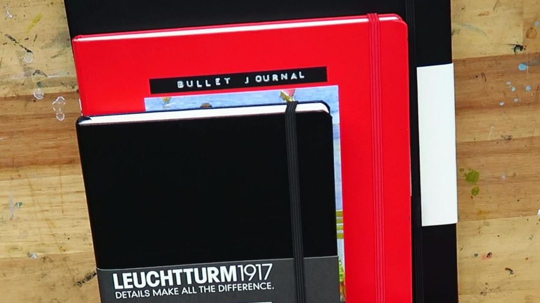 stack of notebooks for bullet journaling; leuchtturm and cangini filippi