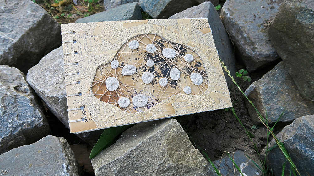 Handbound blank journal with embroidered and grunged cover by Mandy van Goeije