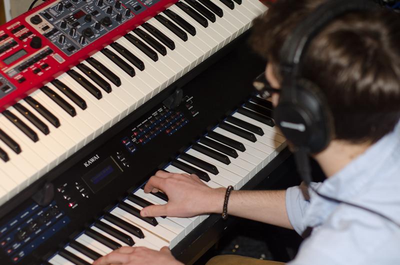 Recording piano parts.
