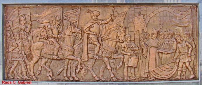 Basorelief de 4 x 1,5 m. Se afla pe soclul statuii ecvestre a lui Mihai Viteazul din Bucuresti aflata in zona Afi Palace Cotroceni.