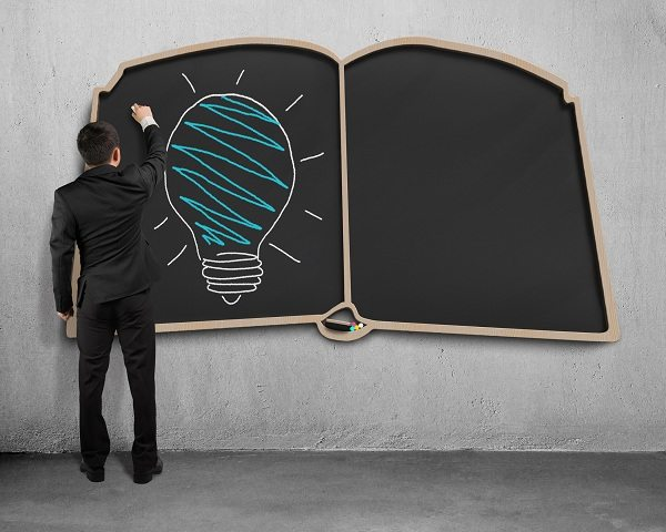 http://www.dreamstime.com/stock-photos-drawing-glowing-lamp-book-shape-blackboard-businessman-standing-image43164803