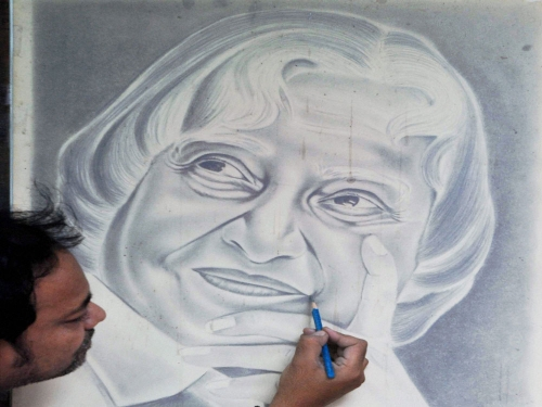 Artist ramzan hussain makes a pencil sketch of former president apj abdul kalam