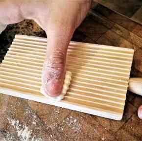 rolling gnocchi on a gnocchi board