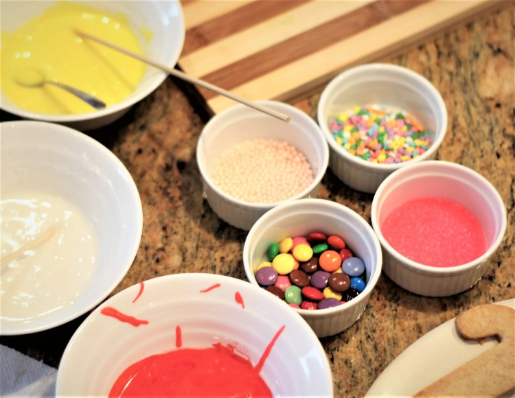 sprinkles and colored icing for decorating cookies