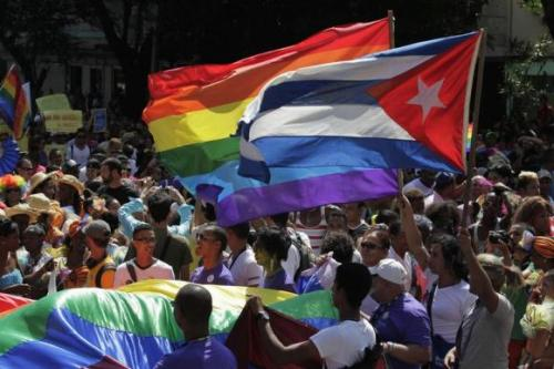 People take part in gay pride parade during an event ahead of International Day Against Homophobia in Havana