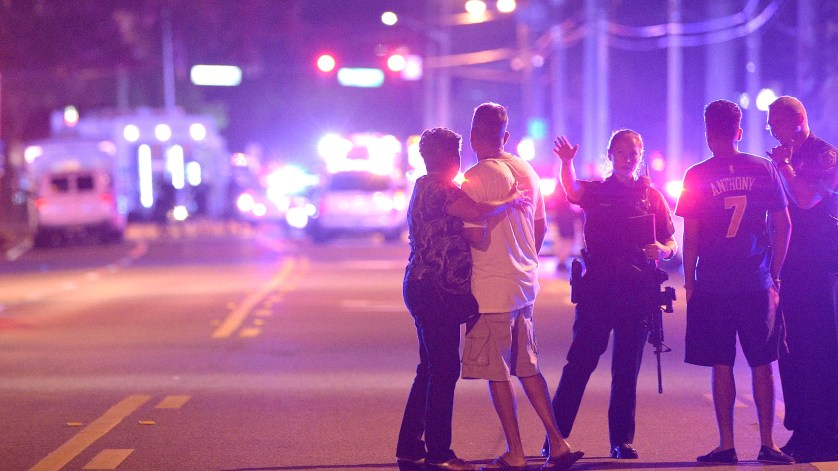 Orlando Police officers direct family members away from a multiple shooting at a nightclub in Orlando, Fla., Sunday, June 12, 2016. A gunman opened fire at a nightclub in central Florida, and multiple people have been wounded, police said Sunday. (AP Photo/Phelan M. Ebenhack)