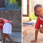 Menina apanha latinhas para comprar comida para cães de rua