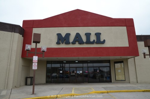 The outside of an old mall says, simply, MALL
