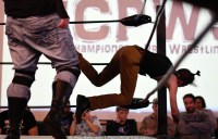 Sam Armstrong has been thrown into the ropes of the wrestleing ring