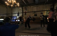 After the match, youngsters learn wrestling falls