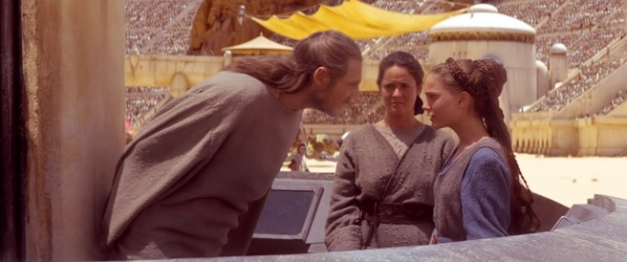 Qui-Gon leans down to tell Padmé to get over it while Shmi looks on with some dismay