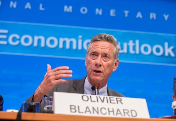 Olivier Blanchard i paneldebatt ved det Internasjonale Pengefondets og Verdensbankens årlige møte den 7.oktober 2014. Foto: IMF Staff Photograph/Stephen Jaffe